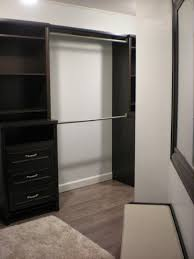 exciting home depot closet organizer with dark wood material and pergo flooring