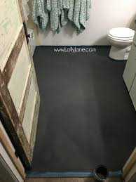 super affordable bathroom floor makeover solution how to chalk paint tile floors so glad