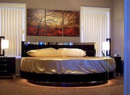 ... Vivacious bedroom with a flashy circle bed at its center