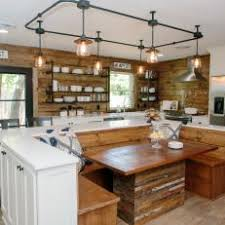 industrial track lighting. eat in open kitchen with built bench seating industrial track lighting and natural wood elements l