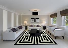modern living room soft white sofas with accent pillows two white chairs modern black coffee table madison lily rugs