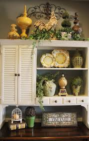 Above Kitchen Cabinet Above Cabinet Decor Greenery Wrought Iron Scroll The Placement