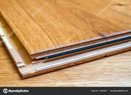 brown wooden parquet floor planks installation close up