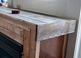 fireplace makeover reclaimed wood mantel