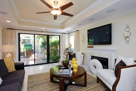small living room with false ceiling and fan