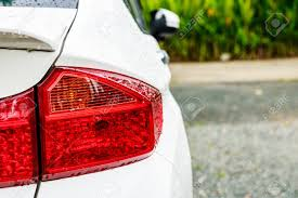 Car Body Lights Selective Focus And Closeup Of Rear Car Lights With Raindrop