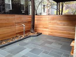 bluestone patio in brooklyn with patterned stone pattern