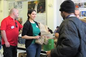 pharmachem volunteers hand out lunch bags at eva s munity kitchen which provides nearly 400 meals a day to guests in the paterson munity