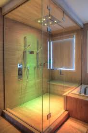 while it s possible to have a glass door installed on a traditional stall glass shower enclosures have