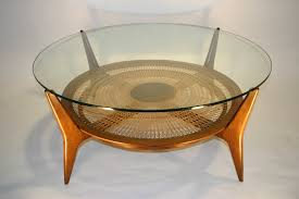 round danish modern coffee table with glass top
