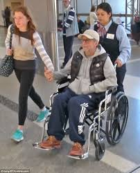 wishing him good health wheelchair bound eric clapton 71 looked frail at lax