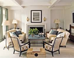 Example of a trendy beige floor living room design in Other with white walls