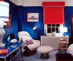 dark blue wall paint, white furniture and red shade curtain