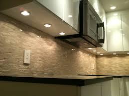 puck lights microwave fan modern kitchen
