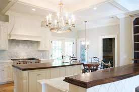 gorgeous kitchen design with gray walls paint color off white creamy kitchen cabinets kitchen island breakfast bar butcher block counter tops