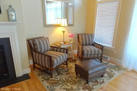Living Room Reveal - corner with chairs ottoman and rug