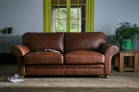 curved arm brown leather sofa