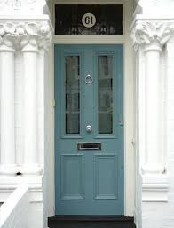 love the idea of blue green colour with traditional victorian gl panels and the number above the door