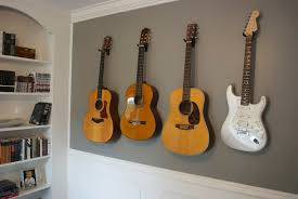 guitars mounted on the wall for easy access and to make his space feel like more of a man space unfortunately we ve never lived any where long