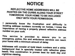 flyer urges residents to pay for house numbers on curbs