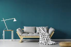 Image Dark Grey Grey Couch And White Lamp Shown Against Dark Bluegreen Painted Wall Gleco Paint Tips For Using Dark Paint Colors Indoors Gleco Paints