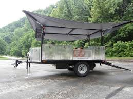 one phase to building the cargo trailer with kitchen and fold out rooftop tent build the roof supports with folding arms to support a canopy diy utility