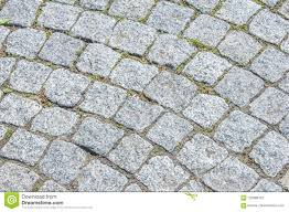 Texture Background The Pavement Of Granite Stone Paved Roadway