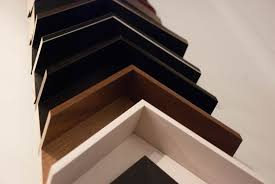 when the paint is dry you cannot smell the chemicals anymore and it is safe to put glass on it our framing allows air