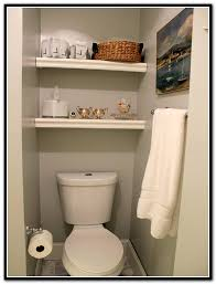 white floating shelves above toilet