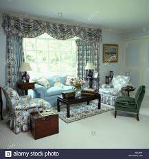 Pale Blue Living Room Blue Pink And White Floral Patterned Drapes And Armchairs In Pale