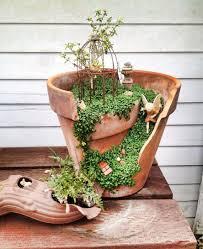fairy garden with birdcage in a pot