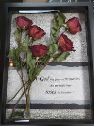 Dried roses from a funeral preserved in display case.