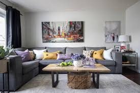 we choose the art with the red umbrella to coordinate with the existing art work this made the wall look more finished the area rug eight new pillows
