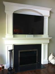 custom fireplace surround tv above fireplace granite face around fireplace glass door by david kimberly
