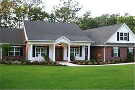 attractive ranch house plan with brick and white lap siding and front porch with columns