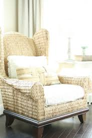 This wicker wingback chair would be perfect on a patio or indoor sunroom