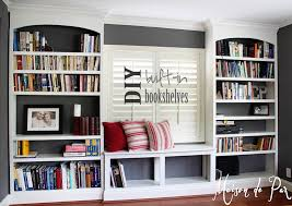 but i m pleased to say that no update is needed as they are finally finished i give to you our new office diy built in bookshelves