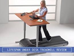 woman using the lifespan under desk treadmill while working