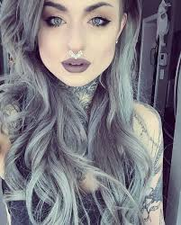 Love her dark lipstick colors and on point eye makeup. If only I.
