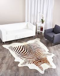 zebra hide rug with leather sofa and chair for living room decoration ideas