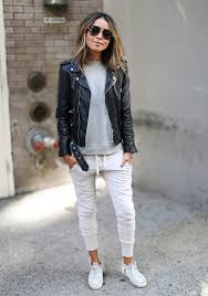 go for a black leather motorcycle jacket and white jogging pants for a casual get