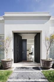 black double front doors. black double front door - entering the garden of a luxurious house doors