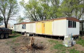 picture of turning a trashed mobile home into a