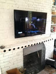 medium size of fireplace wall mount tv hide wires fireplace mounting tv above brick fireplace
