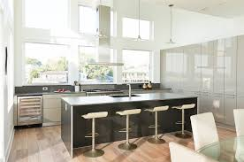 houston high gloss kitchen with contemporary pendant lights and stainless hood dark countertop