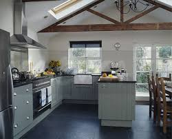 slate floor kitchen. Slate Floor Tiles In Modern White Kitchen And Dining Room Extension With Grey Fitted Cupboards Apex Ceiling