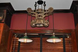 lighting frames. Old Wrought Iron Pulley Lighting Fixtures With Round Shade Dark Brown Window Blinds On Shiny Wood Frames Red Blood Fixture Wall