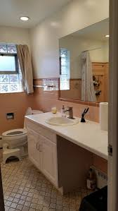 ugly peachy pink tile bathroom
