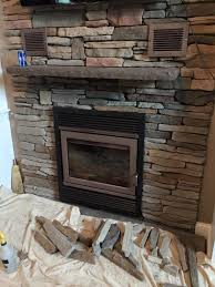 new zero clearance wood stove insert cultured stone veneer hearth and wall in windham