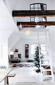 soulful attic apartment in an old villa the home of jewelry designer charlotte wendes absolutely love the wood beams white staircase via boligliv